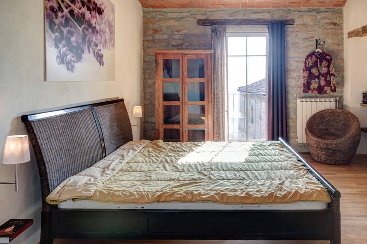 Dormitorios de estilo  por Andrea Chiesa è Progetto Immagine