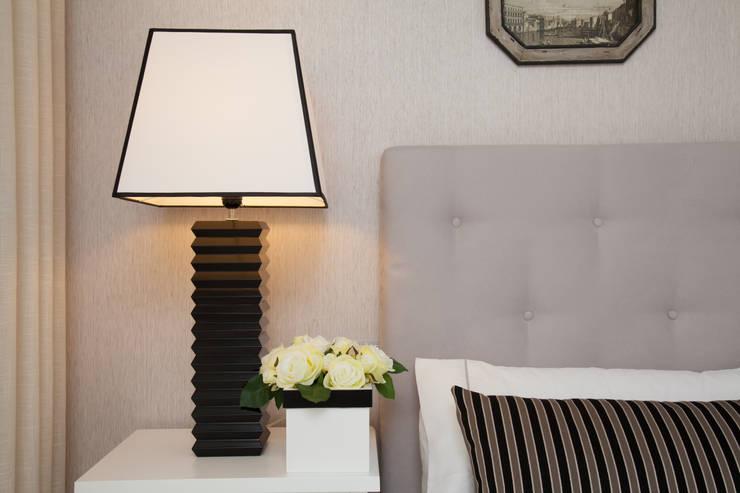QUARTO MORADIA GAIA: Quartos  por Perfect Home Interiors