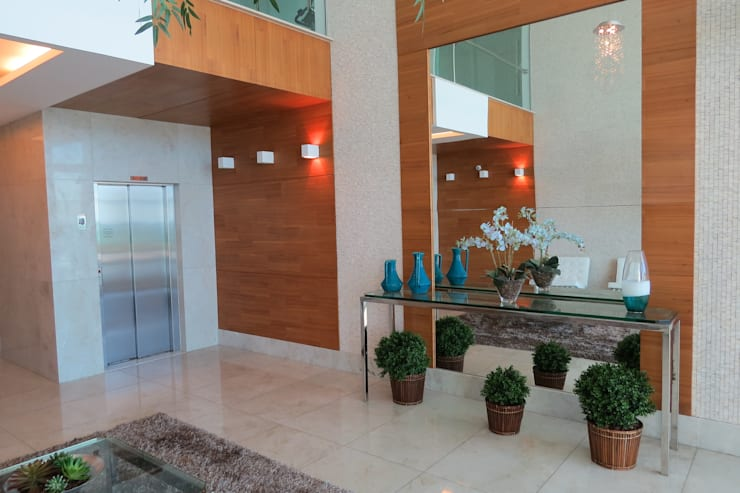 Portaria do edifício Dr. Ramon: Corredores e halls de entrada  por Repsold Projetos e Design