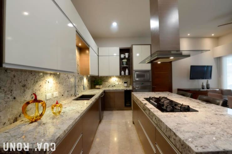 CASA LC: Cocinas de estilo  por UNOCUATRO, Moderno