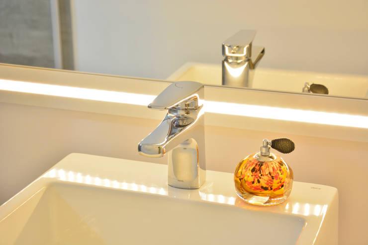 Casas de banho  por Graça Brenner Arquitetura e Interiores,