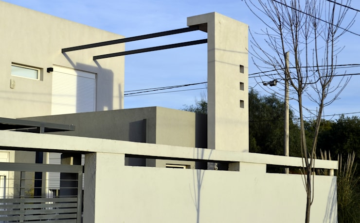 VIVIENDA UNIFAMILIAR en Bahía Blanca.:  de estilo  por ALLERBORN ARQUITECTURA,