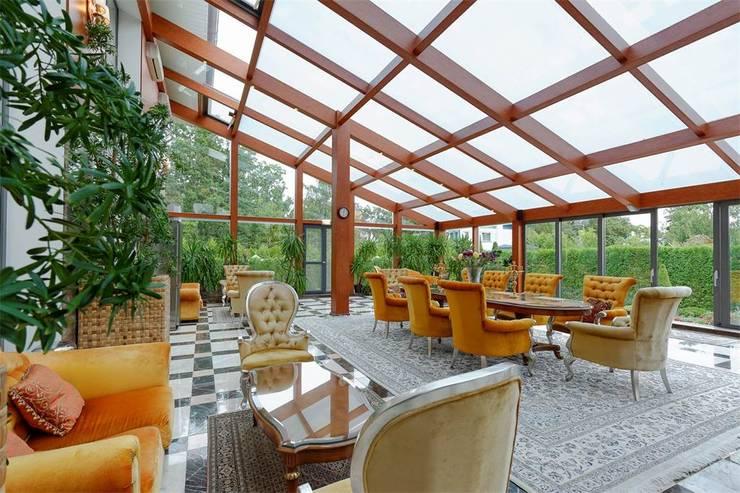 Projekty,  Ogród zimowy zaprojektowane przez Inan AYDOGAN /IA  Interior Design Office