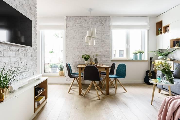 Comedores de estilo escandinavo por Saje Architekci Joanna Morkowska-Saj