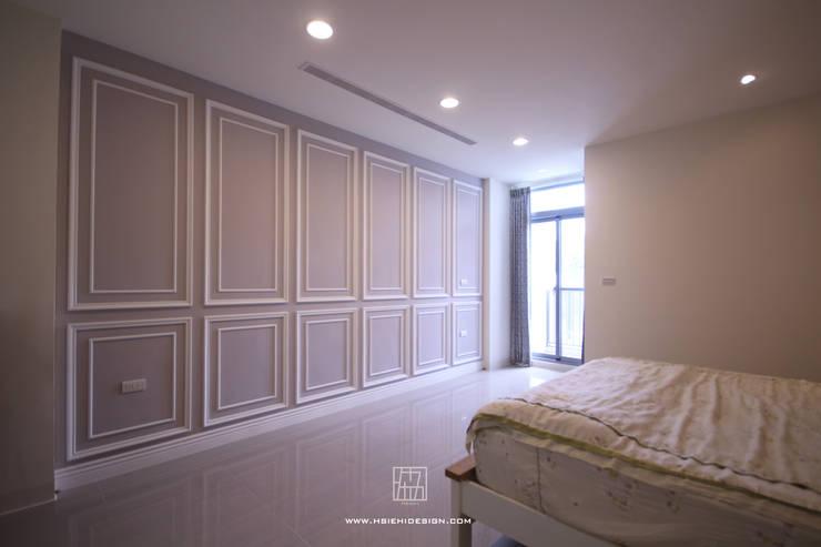 主臥室牆面造型:  牆面 by 協億室內設計有限公司