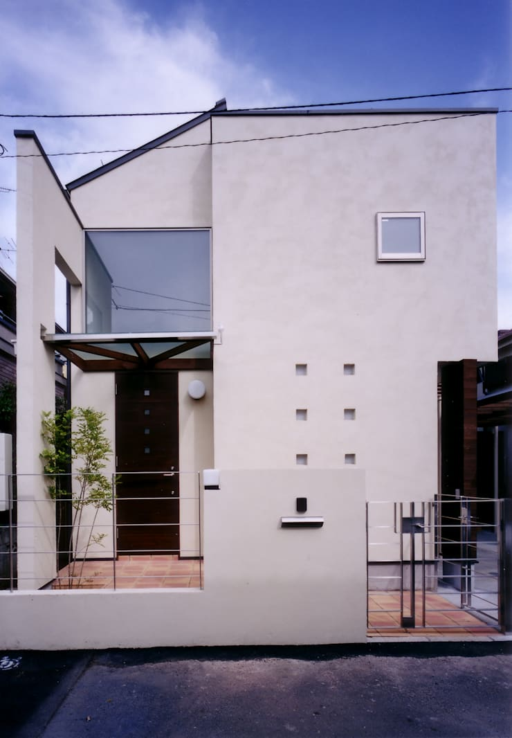 Houses by 豊田空間デザイン室 一級建築士事務所, Modern Solid Wood Multicolored