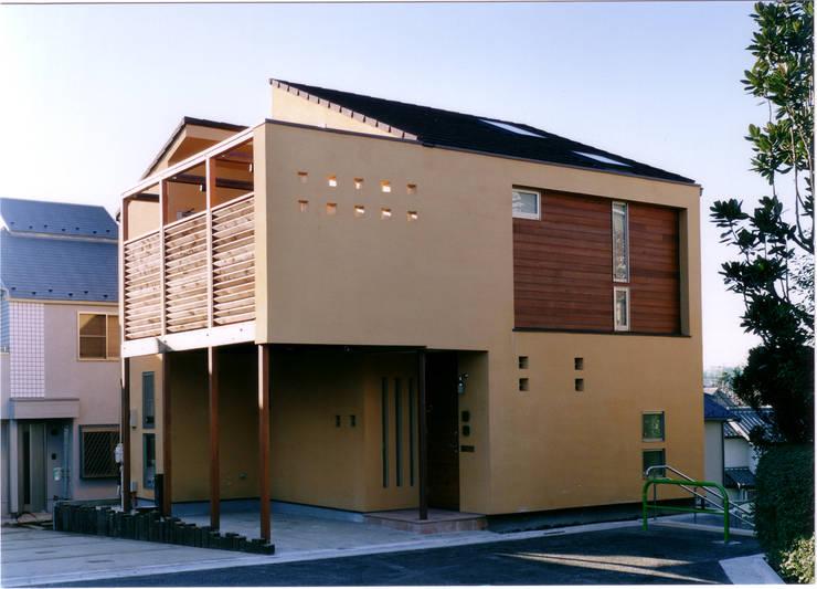 Casas eclécticas de 豊田空間デザイン室 一級建築士事務所 Ecléctico