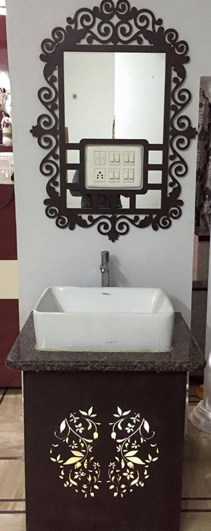 Mangla's Dining Wash basin : modern  by Designelle,Modern
