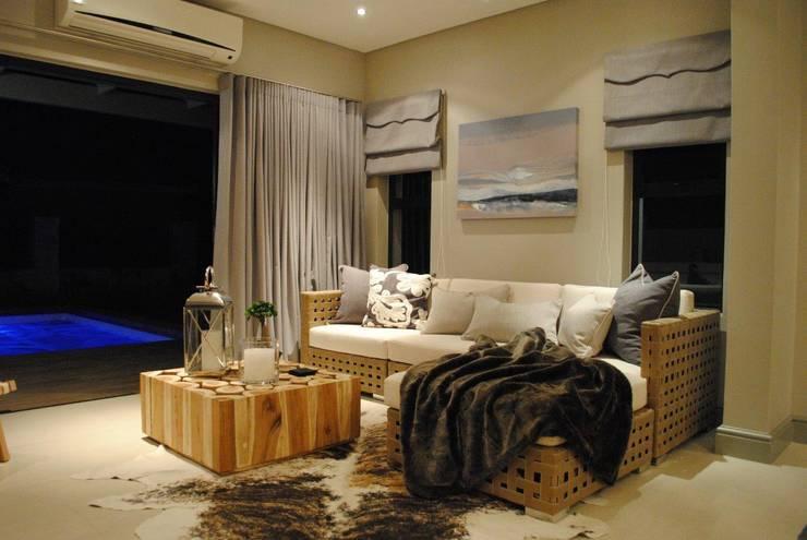 Braai room:  Living room by Salomé Knijnenburg Interiors, Modern