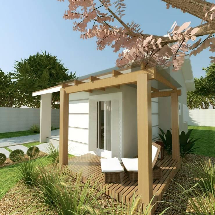 Casa de alvenaria com deck e pergolado:   por Cíntia Schirmer   Estúdio de Arquitetura e Urbanismo