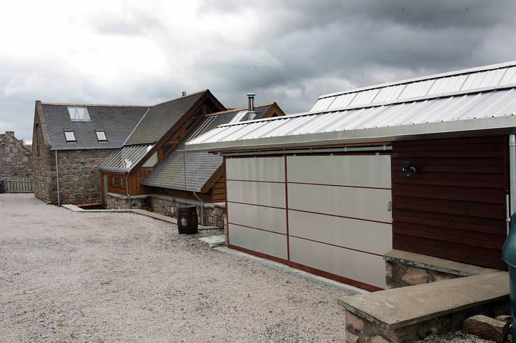 Garajes de estilo  por Retool architecture