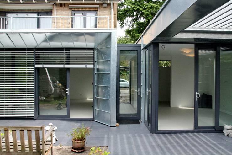 Moderne Uitbouw en aanbouw:  Huizen door Architectenbureau Jules Zwijsen