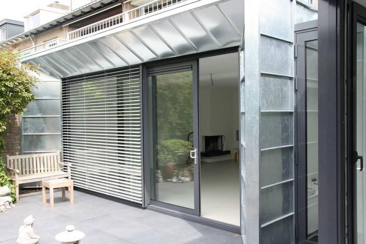 Moderne Uitbouw en aanbouw:  Ramen door Architectenbureau Jules Zwijsen