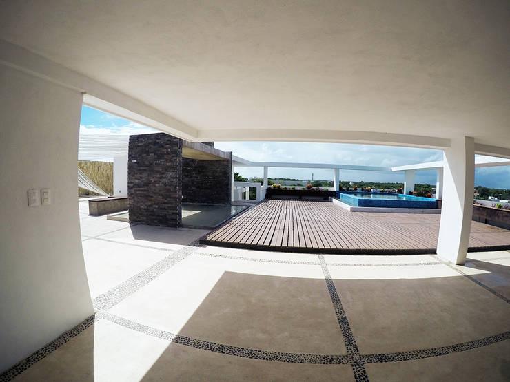 Casa Tunich: Jardines de estilo  por Grupo Cerma , Moderno