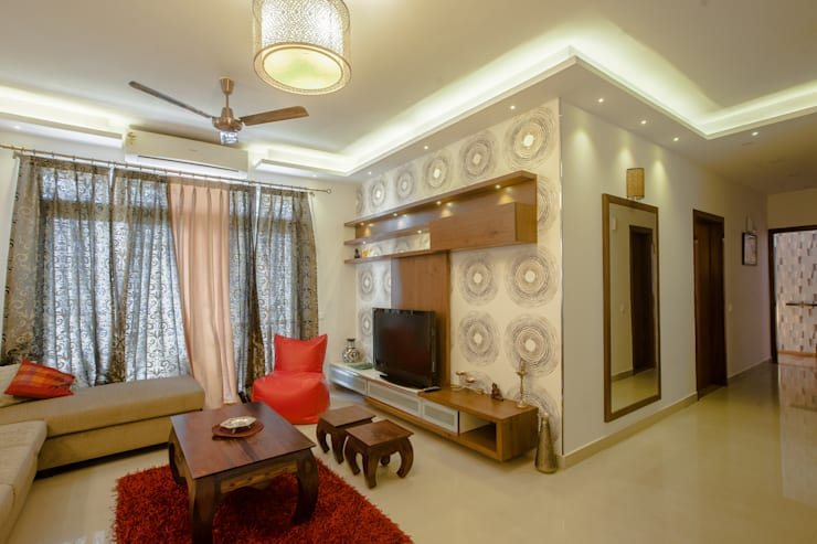 3 BHK partement : modern Living room by In Built Concepts