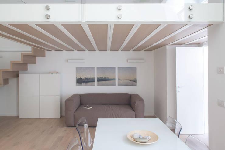 Projekty,  Salon zaprojektowane przez STUDIO ACRIVOULIS      Architettra + Interior Design