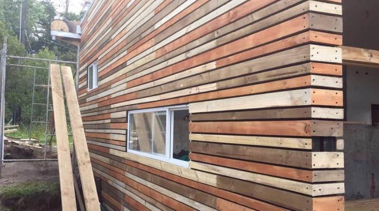 Tabique ventilado.: Casas de estilo  por Cordova Arquitectura y Construcción .