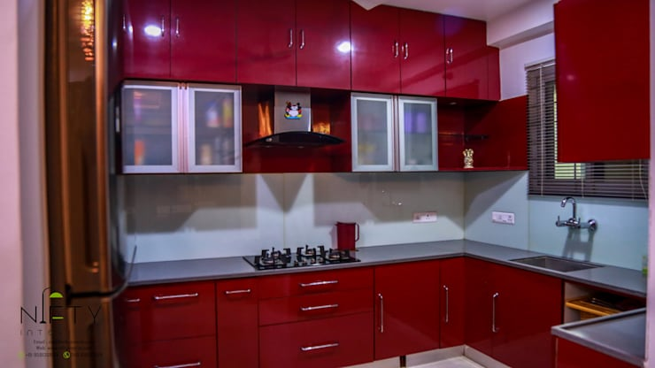 Residence Project with Modern and Colorful Design:  Kitchen by Nifty Interio