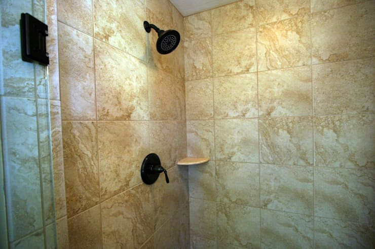 Bathroom uses Mosaic tile of Natural Stone: modern Bathroom by Outer Banks Renovation & Construction