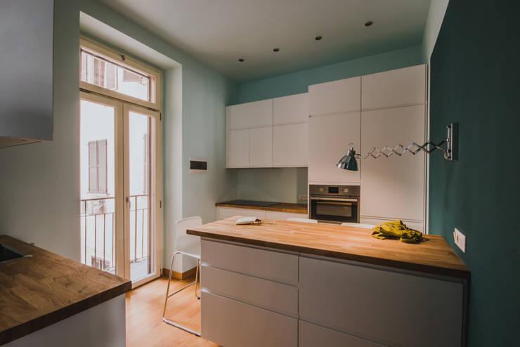 modern Kitchen by luogo comune