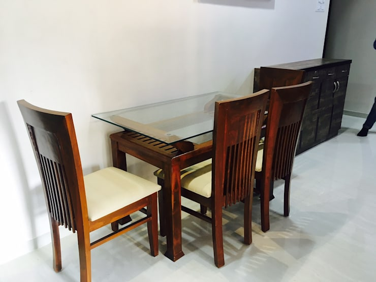 Modern dining room by SHARADA INTERIORS Modern