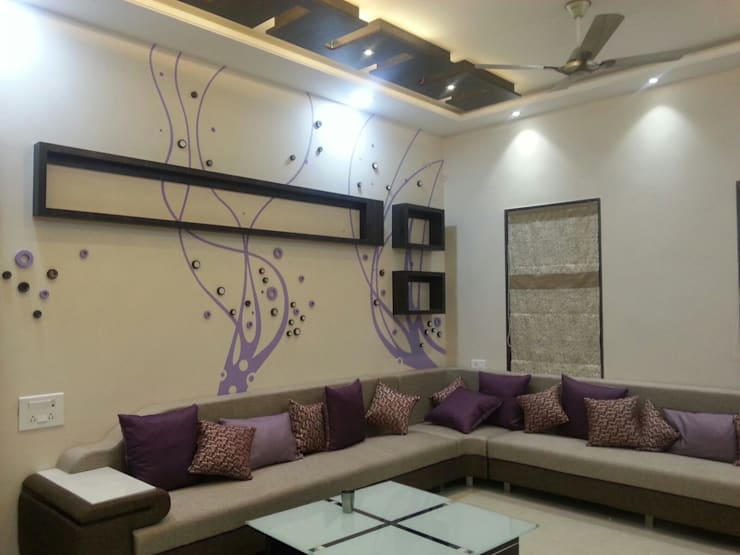 Living room by YOJNA ARCHITECTS