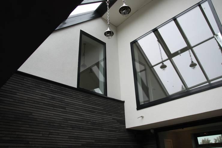 Modern Landhuis:  Serre door Architectenbureau Jules Zwijsen, Modern