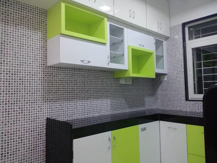 2 BHK RESIDENTIAL PROJECT  @2016:  Kitchen by SHARADA INTERIORS