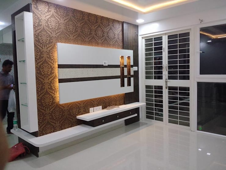 2 BHK RESIDENTIAL PROJECT  @2016:  Living room by SHARADA INTERIORS,Modern