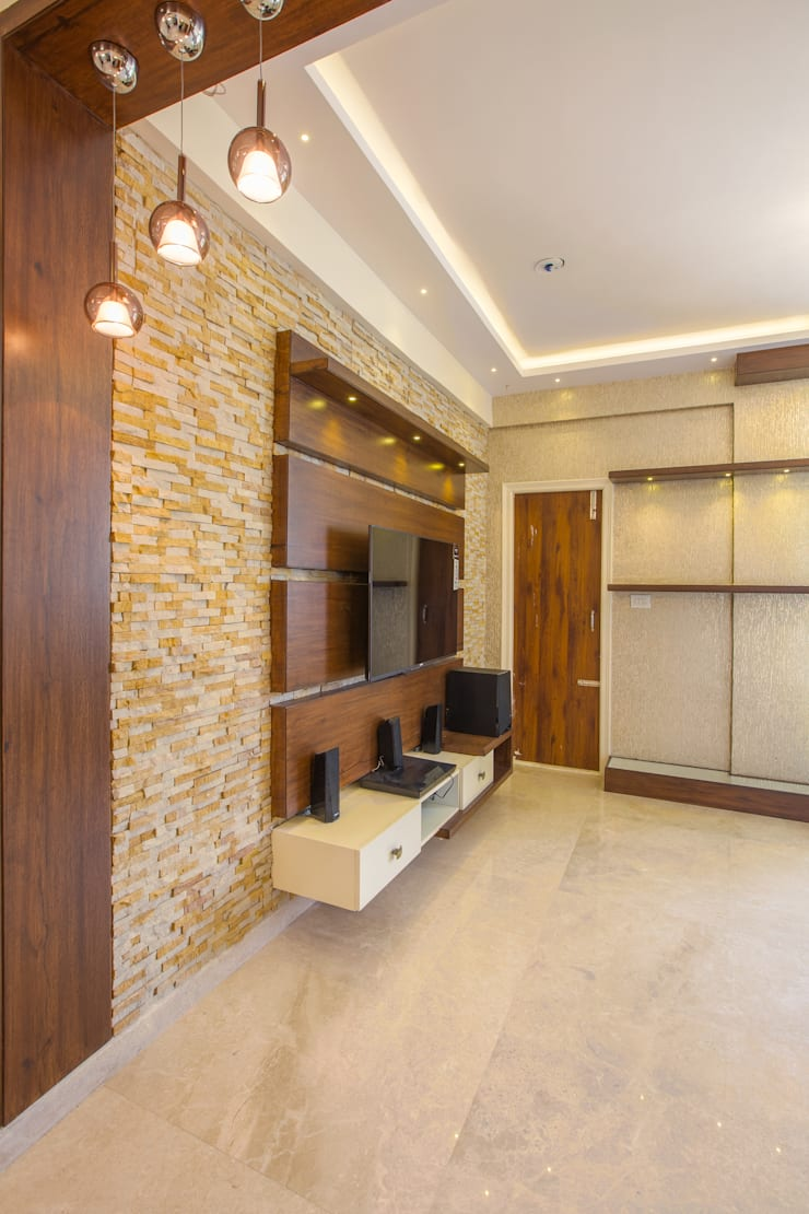 3 BHK apartment interiors in rustic look theme : classic  by In Built Concepts,Classic Plywood
