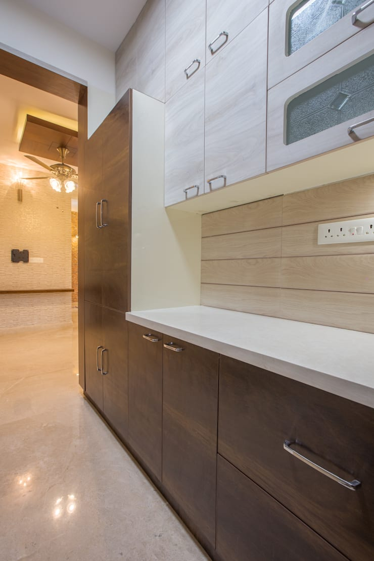 3 BHK apartment interiors in rustic look theme :  Kitchen by In Built Concepts,Classic Plywood