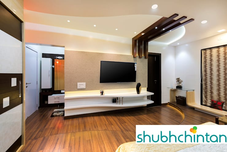 master bed T.V. Unit: modern Bedroom by shubhchintan