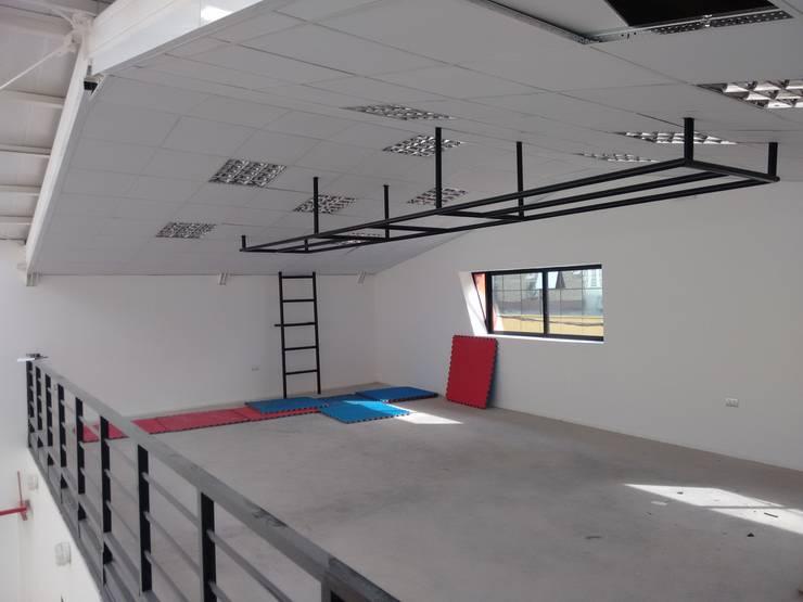 Vista interior-Segundo nivel: Estadios de estilo  por DIMA Arquitectura y Construcción