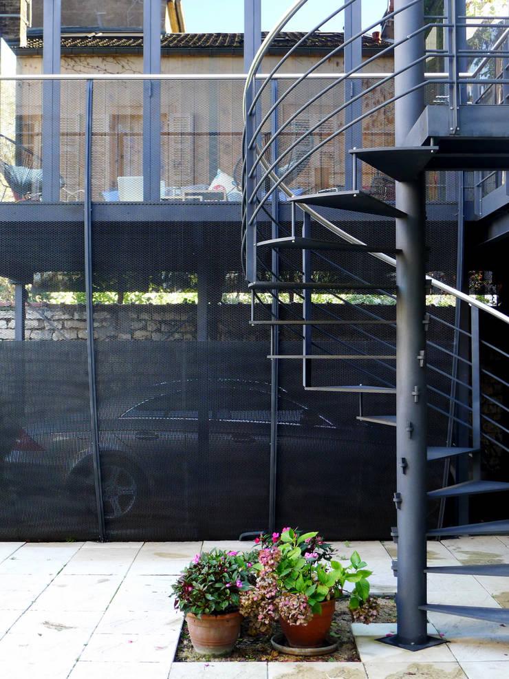 Jardines de invierno de estilo moderno de Vincent Athias Architecte DPLG Moderno Hierro/Acero