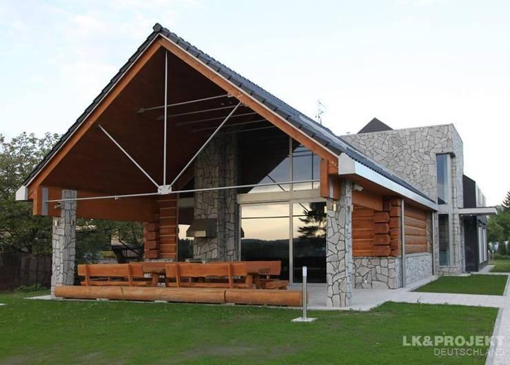 Casas de estilo  por LK&Projekt GmbH