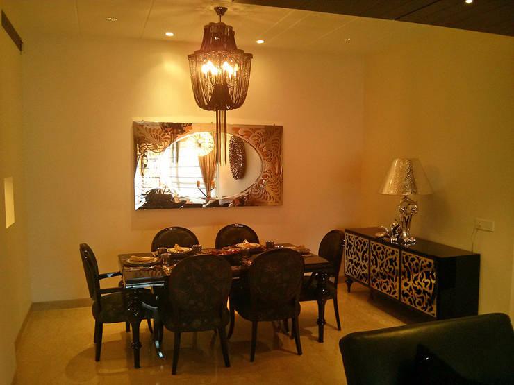 Dining room by Studio Sohaib, Modern