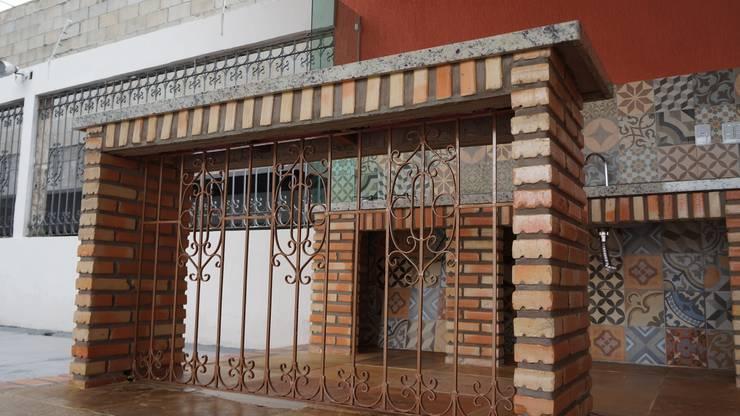 de estilo  por Reinaldo Pampolha Arquitetura