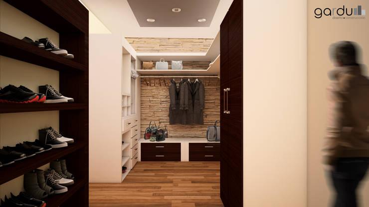 Closeth Moderno : Vestidores y closets de estilo  por GarDu Arquitectos , Minimalista Madera Acabado en madera