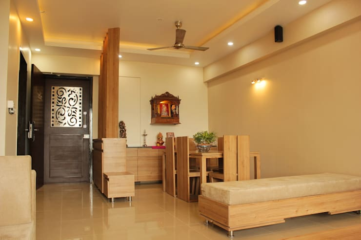 Mr. Jitendra Pathak:  Living room by GREEN HAT STUDIO PVT LTD
