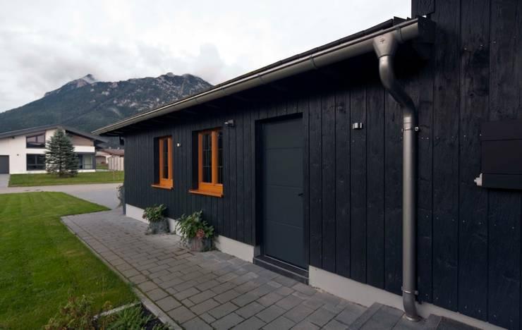 Houses by w. raum Architektur + Innenarchitektur,