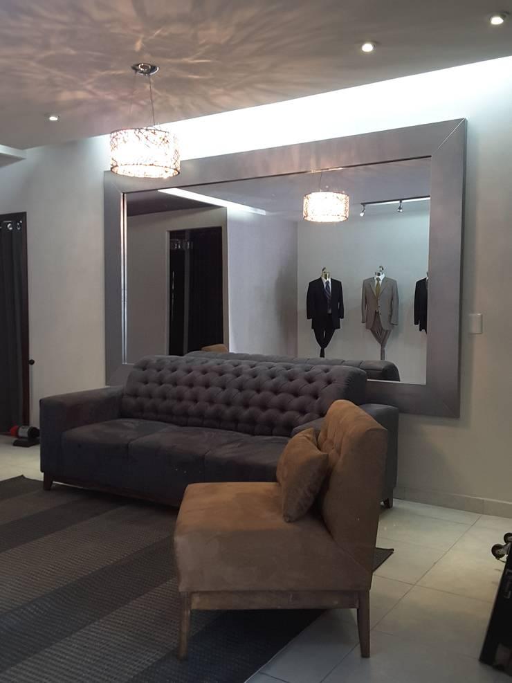 SALA DE ESPERA: Salas de estilo  por Lasso Design Studio