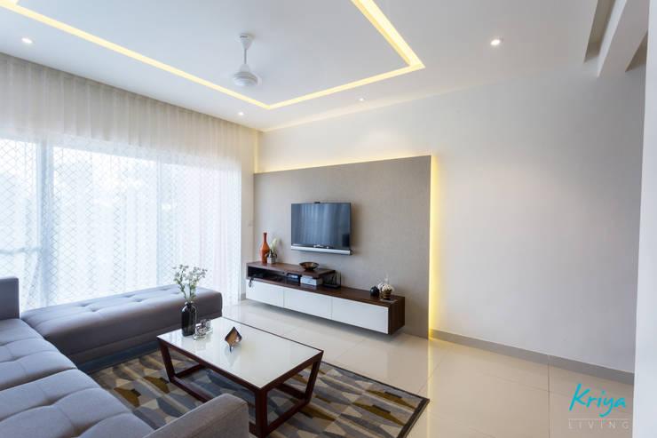 3 BHK apartment—RMZ Galleria, Bengaluru:  Living room by KRIYA LIVING