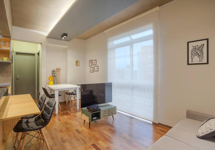 SALA DE TV E JANTAR: Salas de jantar  por Botti Arquitetura e Interiores-Natália Botelho e Paola Corteletti