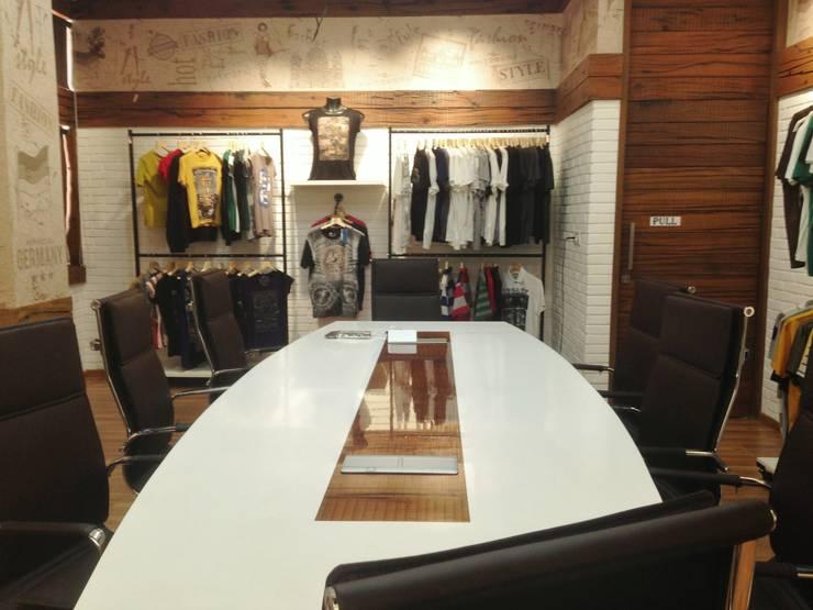 Sales Studio cum conference :  Commercial Spaces by Core Design