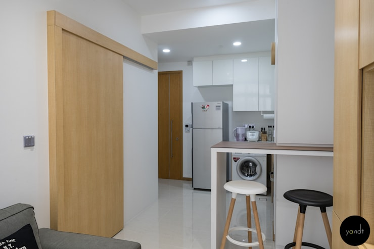 Newly erected partition wardrobe area with sliding door: scandinavian Kitchen by Y&T Pte Ltd