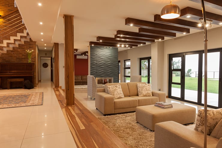 House Naidoo:  Living room by Redesign Interiors, Modern