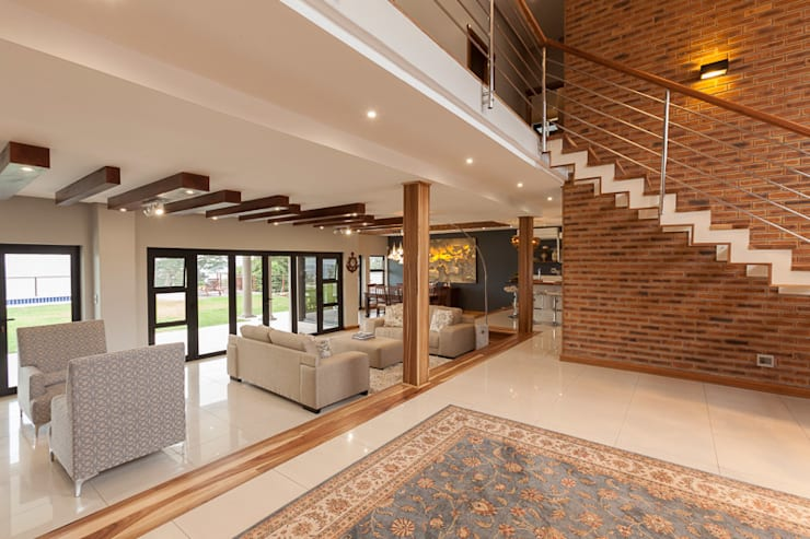 House Naidoo:  Living room by Redesign Interiors