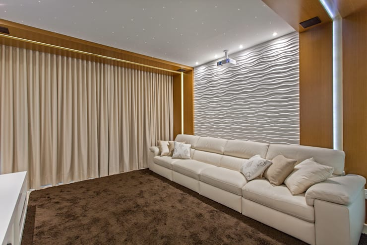 Salas multimedia de estilo moderno por Designer de Interiores e Paisagista Iara Kílaris