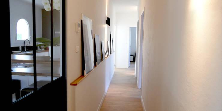 Pasillos y vestíbulos de estilo  por Ophélie Dohy architecte d'intérieur