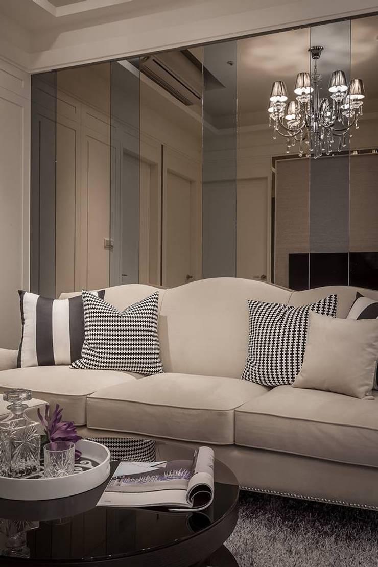 沙發背牆:  客廳 by 你你空間設計